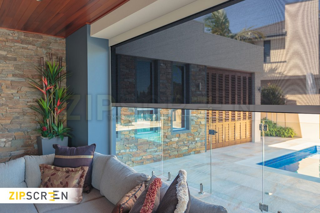 Beautiful see through zipscreen privacy blind in outdoor area offering unobstructed views of the swimming pool