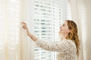 looking outside clean timber shutters