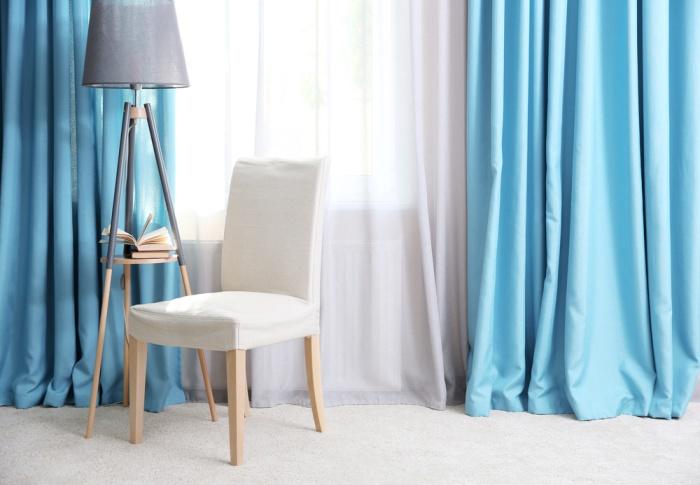 blue curtains maintaining a bright home decor